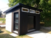 """Check out this gorgeous build by Sam, in Quebec. He writes """"There isn't pre-made cement boards available in Quebec, Canada so we used Hardiebacker that we cut and painted ourselves. As for the wood, it's cedar planks that I've burnt with a roof torch, brushed and then applied a natural tung oil for maximum protection."""" He also writes """"...[the] neighbors are jealous. :)"""" Rightly so! This is an amazing build. I love the finishing on the underside of the soffit (don't forget to vent!) and the burned/ oiled finish on the vertical siding boards."""