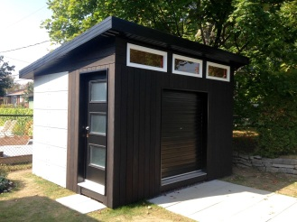 "Check out this gorgeous build by Sam, in Quebec. He writes ""There isn't pre-made cement boards available in Quebec, Canada so we used Hardiebacker that we cut and painted ourselves. As for the wood, it's cedar planks that I've burnt with a roof torch, brushed and then applied a natural tung oil for maximum protection."" He also writes ""...[the] neighbors are jealous. :)"" Rightly so! This is an amazing build. I love the finishing on the underside of the soffit (don't forget to vent!) and the burned/ oiled finish on the vertical siding boards."