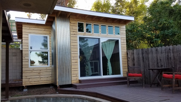 Mark in L.A. took the concept up a notch by adding a small extension to the side and thereby expanding the space, and complimenting the design. I love the clean, light lines of the siding boards and the use of vertical roofing panels for siding accents.